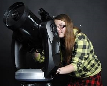 woman looking through a telescope