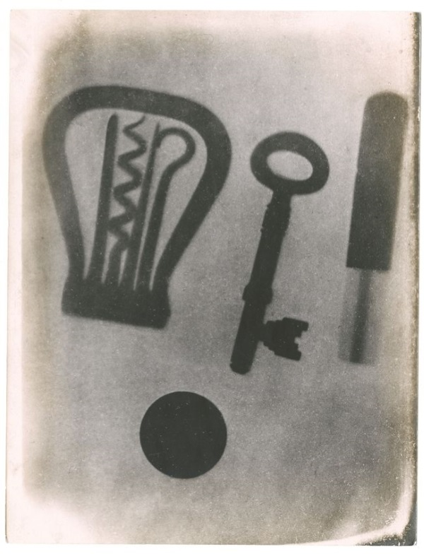 X-ray photograph of objects in a calico pocket, including a folding corkscrew, key and coin, by A A Campbell Swinton, 1896.