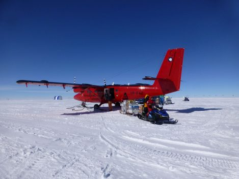 Unloading science cargo from a British Antarctic Survey Twin Otter plane