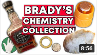 Brady presents some chemistry-related objects in his office.
