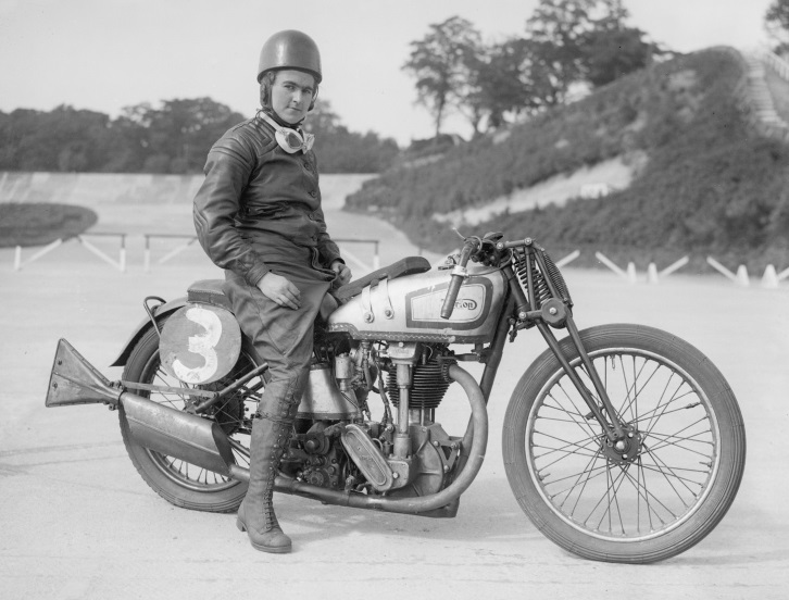Beatrice Shilling sits astride her Norton motorcycle (1935)