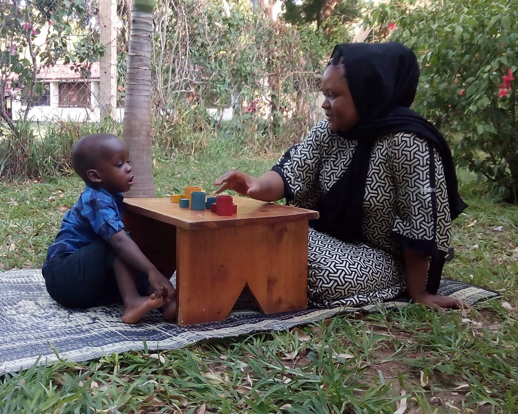 Dr Amina Abubakar assessing a child using the Kilifi Developmental Inventory. Picture courtesy of Moses K. Nyongesa.