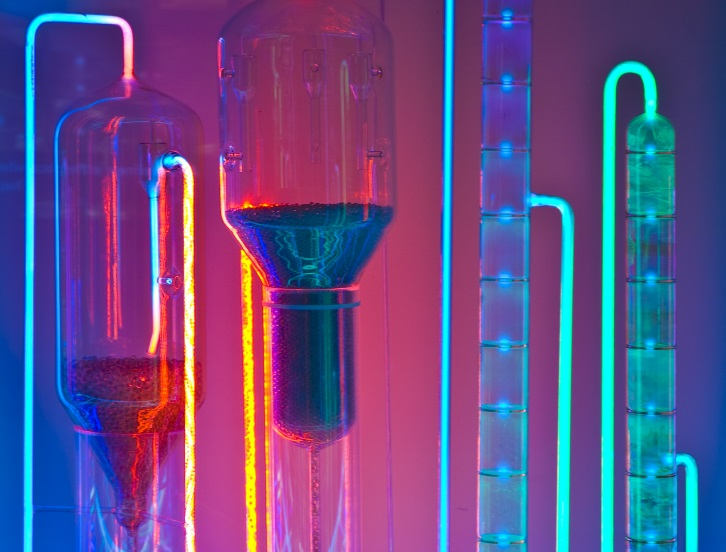 Glowing chemicals in scientific apparatus. Image credit: iStock
