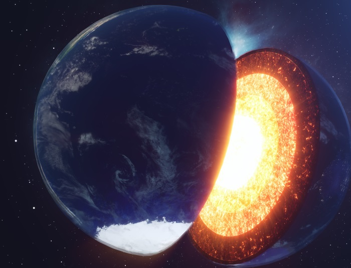 Artist impression of what lies beneath the surface of the Earth. Image shows the Earth cut in half through the poles with layers of glowing magma.