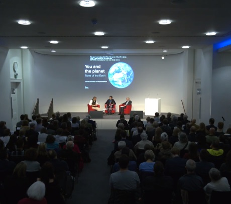 Panel discussion in front of audience at You and the Planet: State of the Planet event