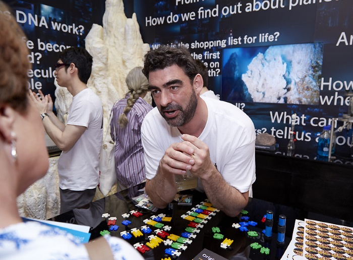 Dr Nick Lane, a biochemist and writer from UCL, speaks to a member of the public at the Royal Society Summer Science Exhibition.