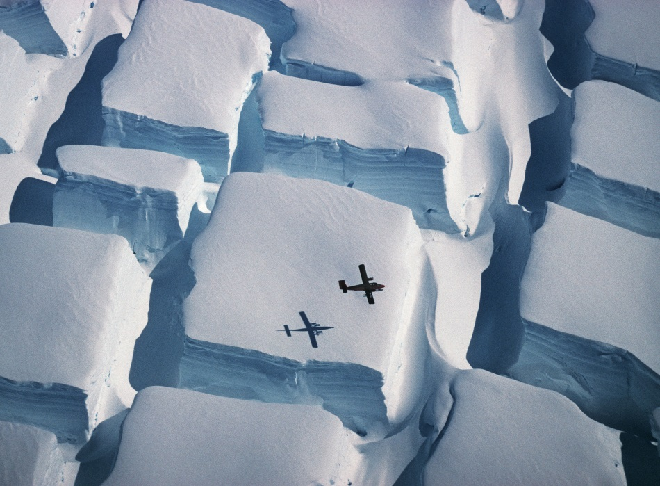 Plane flying over Antarctica, by Peter Convey