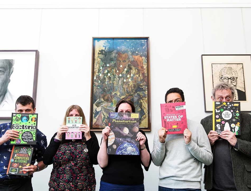 Five judges of the 2019 Royal Society Young People's Book Prize holding six of their shortlist selections