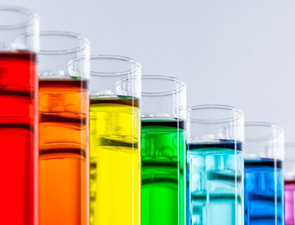 Test tubes with brightly coloured liquid.