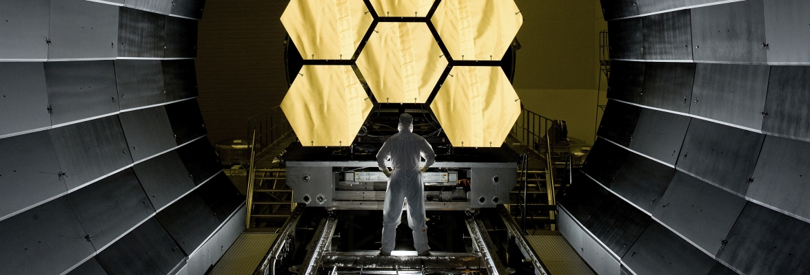 NASA engineer Ernie Wright looks on as the first six flight ready Webb Space Telescope