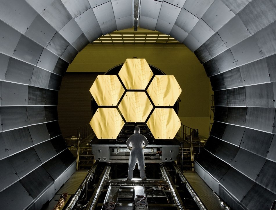 NASA engineer Ernie Wright looks on as the first six flight ready Webb Space Telescope's primary mirror segments are prepped to begin final cryogenic testing at NASA's Marshall Space Flight Center. This represents the first six of 18 segments that will form NASA's Webb Space Telescope's primary mirror for space observations. Engineers began final round-the-clock cryogenic testing to confirm that the mirrors will respond as expected to the extreme temperatures of space prior to integration into the telescope's permanent housing structure. Image Credit: NASA/MSFC/David Higginbotham - https://www.flickr.com/photos/nasawebbtelescope/5621574713/in/album-72157629134274763/