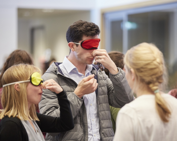 The Crick science buskers getting blindfolded audience members to guess things by smell and taste
