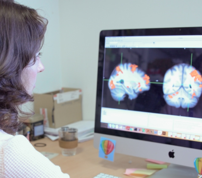 Dr Sarah Finnegan viewing brain activity recorded using functional magnetic resonance imaging