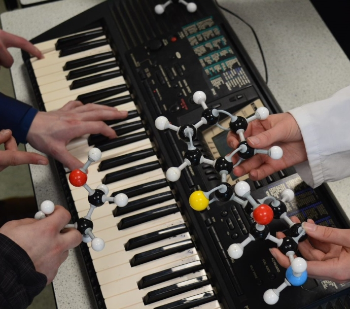 Students working on converting a chemical into music