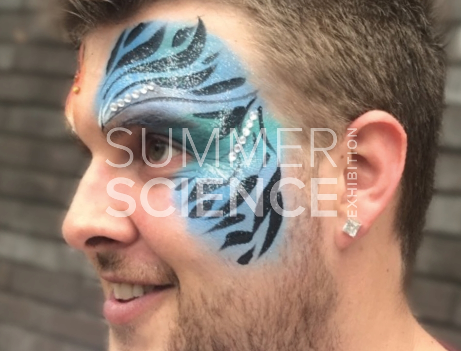 Summer Science Exhibition: man with colourful facepaint on one side of his face