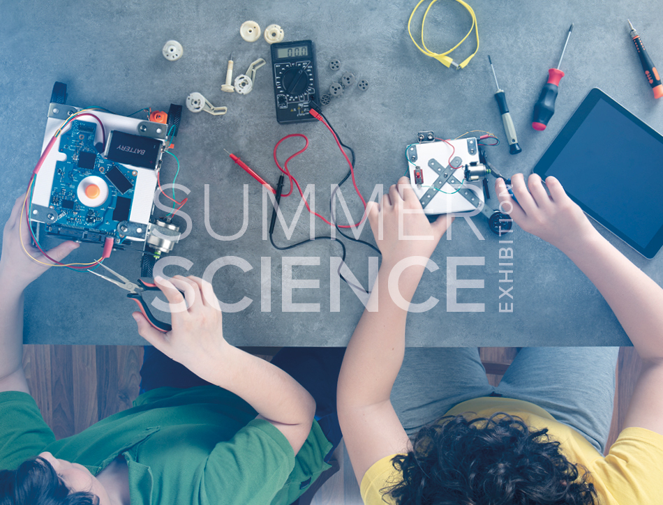 Summer Science Exhibition: two children building table-top robots