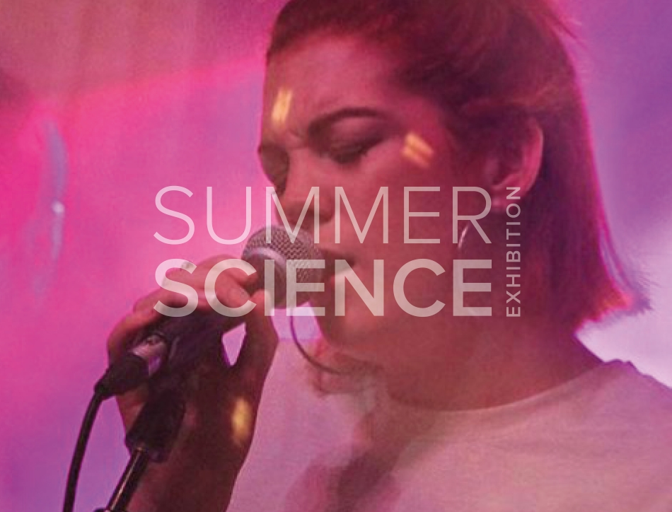 Summer Science Exhibition: Grace Savage beatboxing into a microphone in front of pink and purple lighting