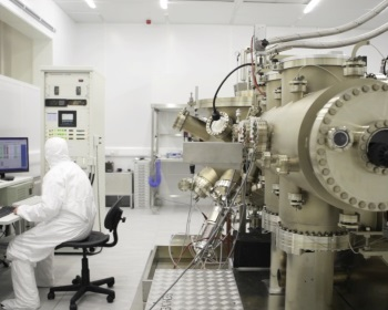 lab - man in white full body overalls with big machinary