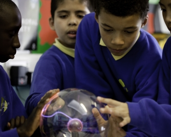children at school getting involved with a science experiment to do with heat and energy