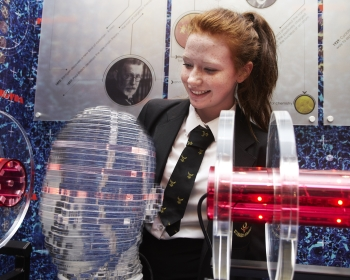 female school pupil interacting with science experiments