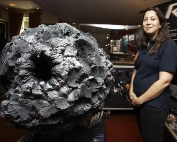 female scientist stood next to a meteor at the summer science exhibition