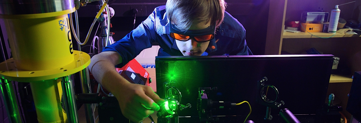 A research student working in an optical laboratory performing some of the first measurements on optical security tags. Credit: Lancaster University