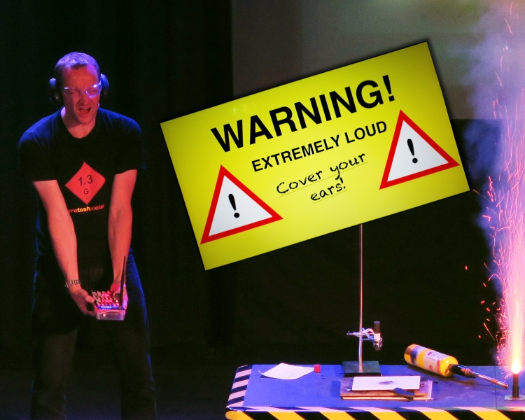 A man causing an explosion indoors with a 'warning' sign in the background